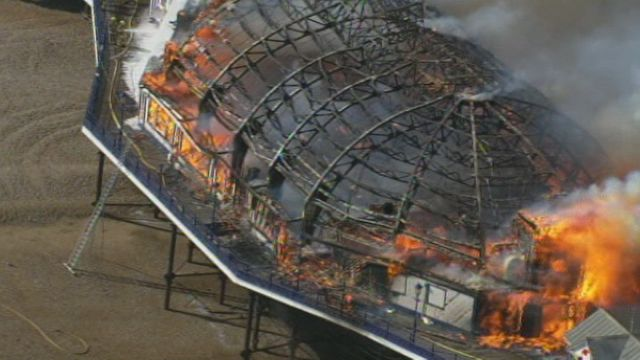 News video: Fire rages on Eastbourne Pier as arcade catches alight